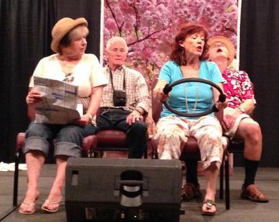 four elderly actors in a car scene