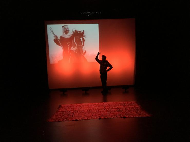 an actor's silhouette on stage