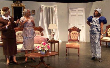 three actresses in a living room onstage