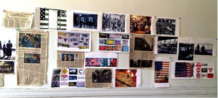 Collage of photographs and newspaper clippings on a wall