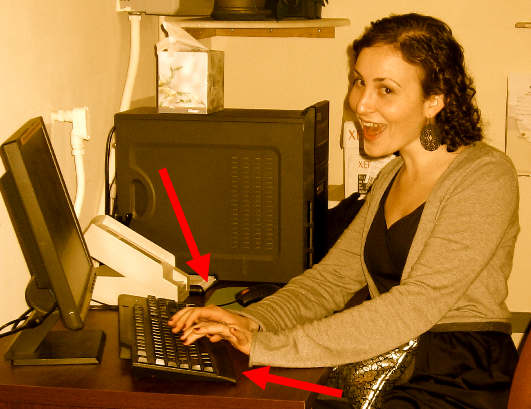 a woman smiling at her computer
