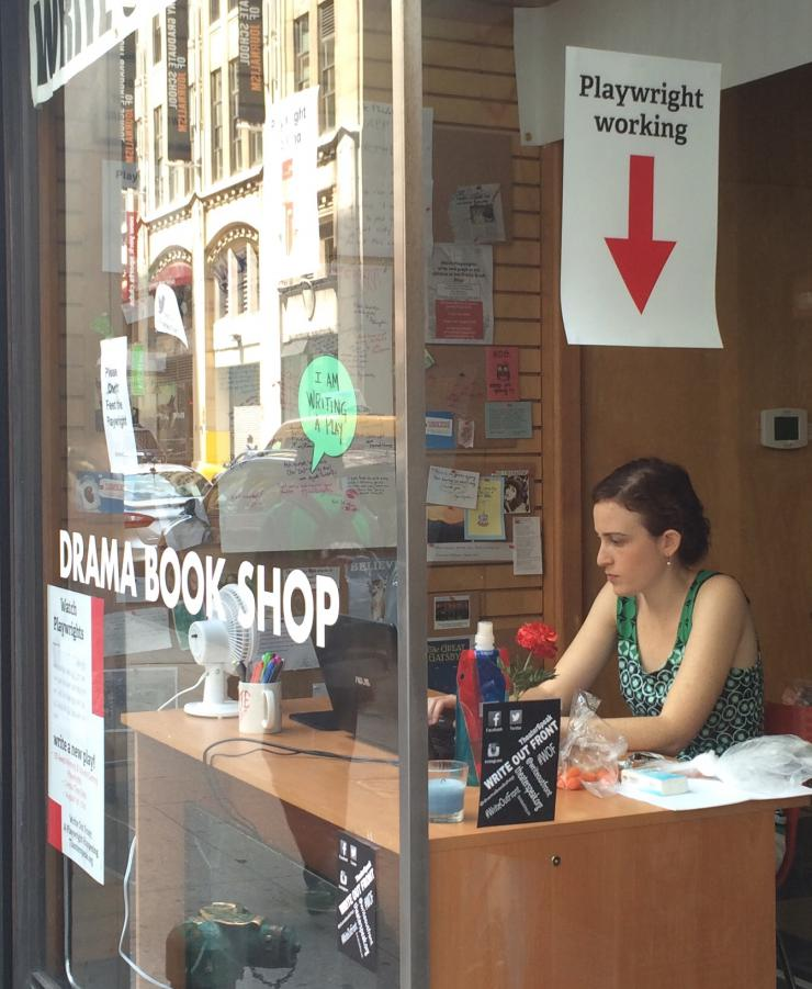 author working at a window