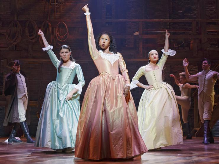 three women on stage