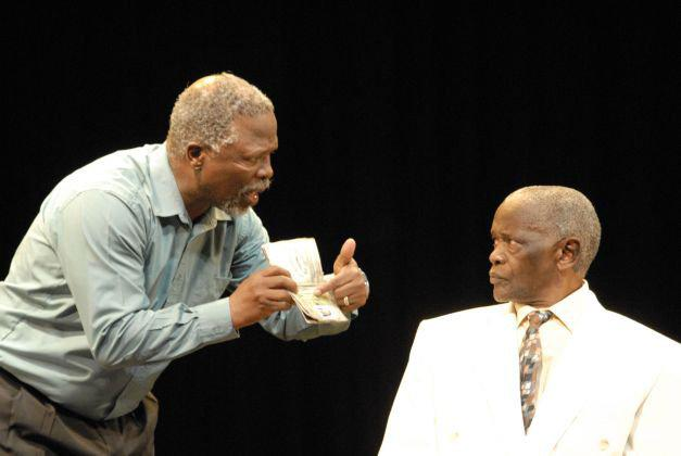 two actors arguing on stage