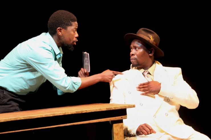 two actors arguing on stage in parallel to previous photo