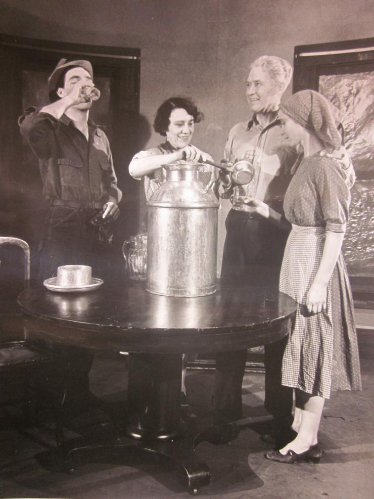 four actors around a pot of soup
