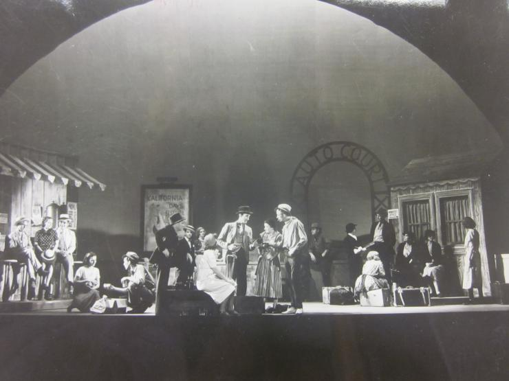 a ful company on stage