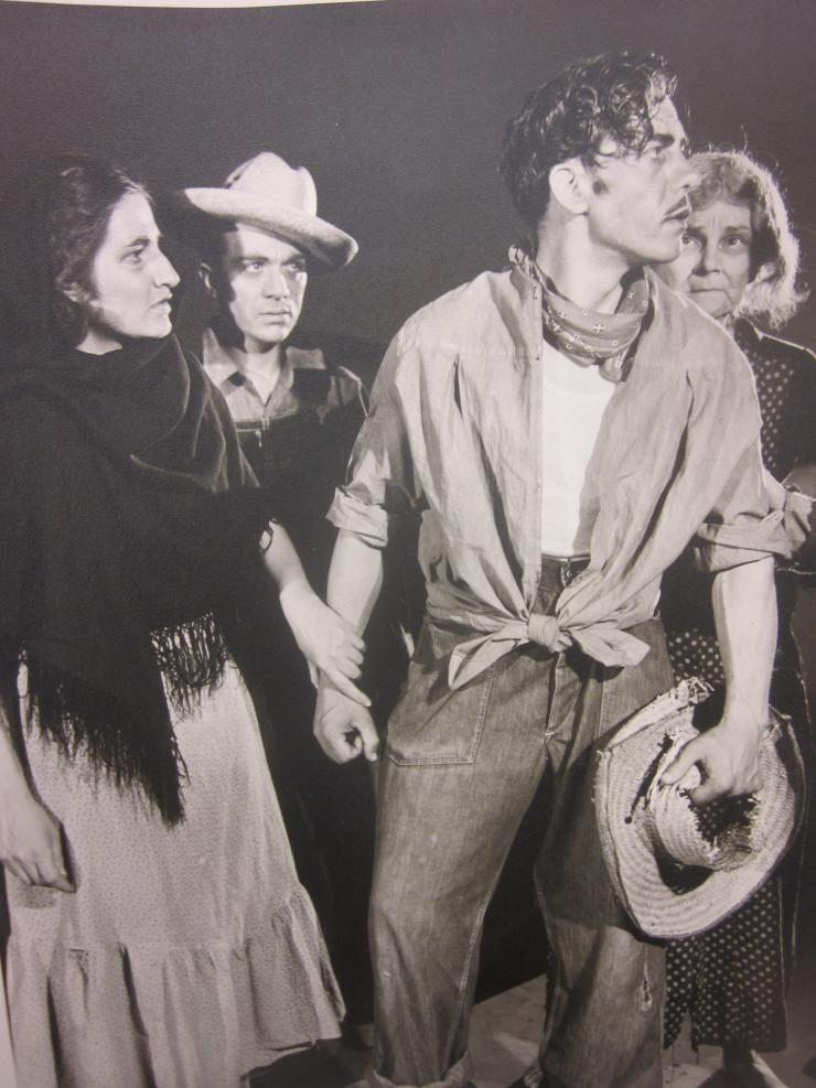 a group of actors performing a scene