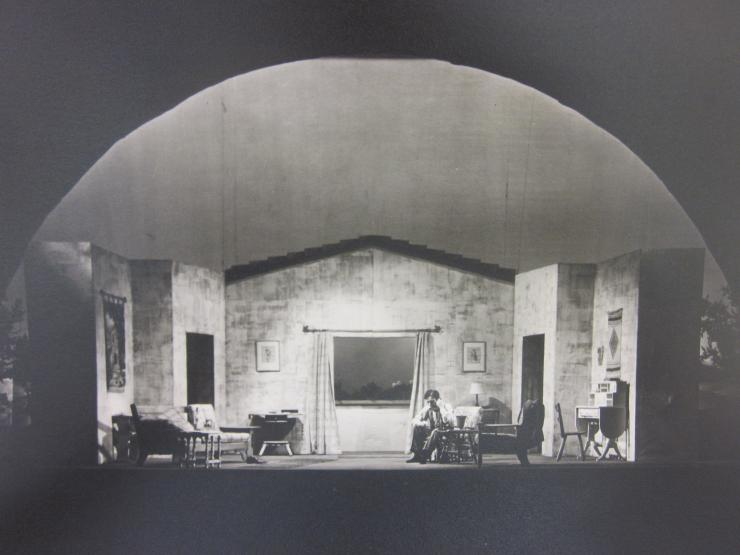 an actor alone in a living room on stage