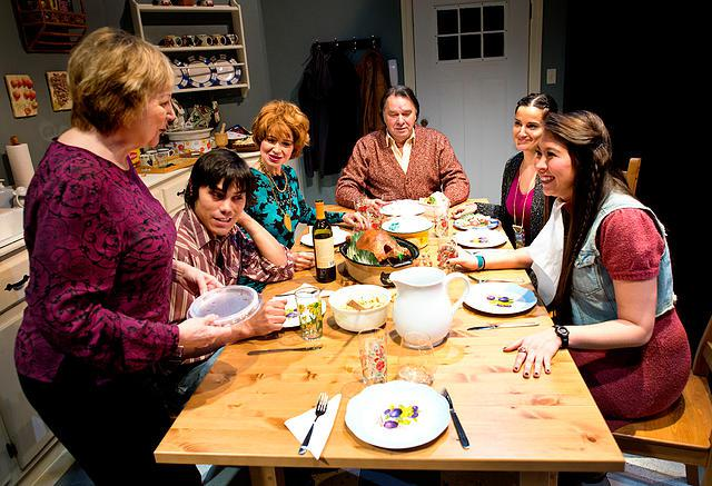 Actors in a scene at the dinner table
