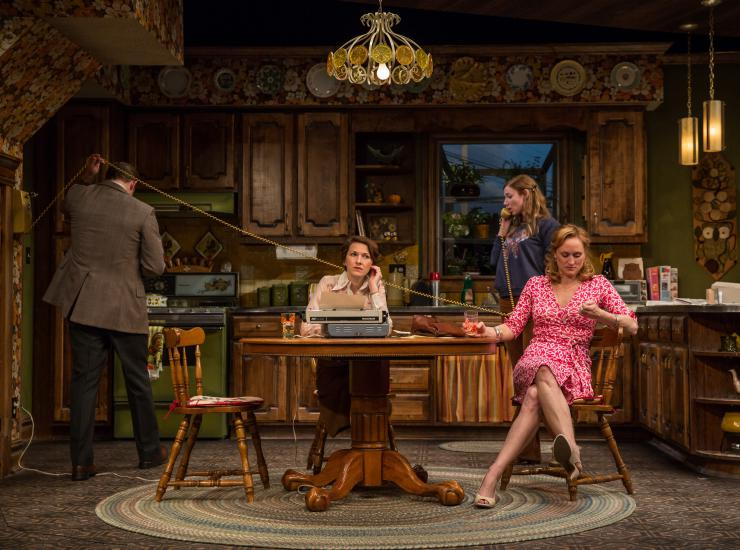 a group of actors in a kitchen on stage