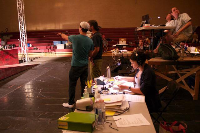 a stage manager at her desk