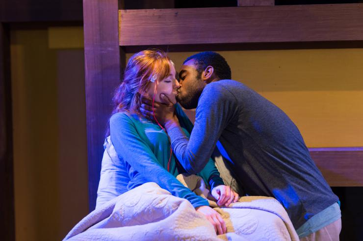 two actors kissing on stage