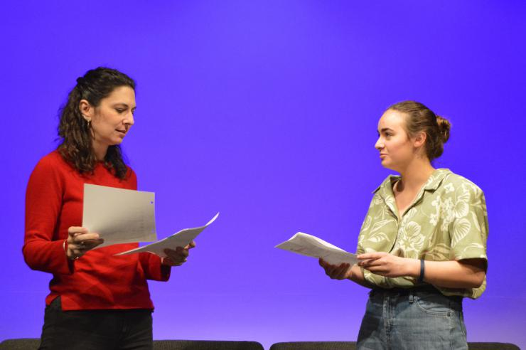two performers in a staged reading