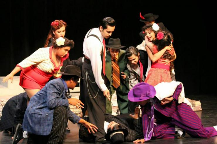 a group of young actors on stage in period costumes