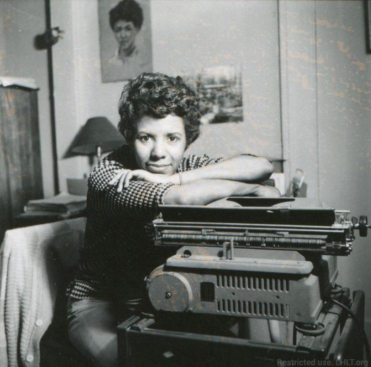 a woman sitting by her type writer