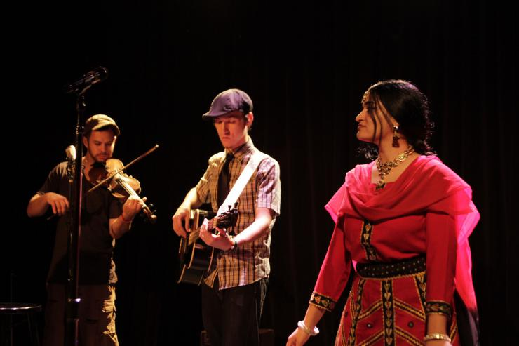 an actress with musicians on stage