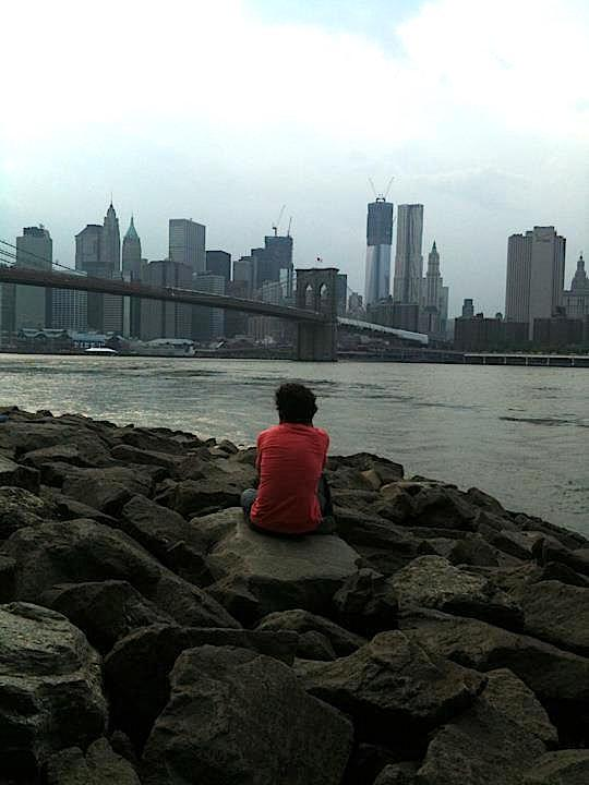 author looking out at the new york skyline