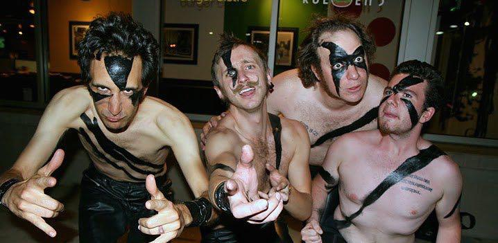 a group of men dressed as a metal band