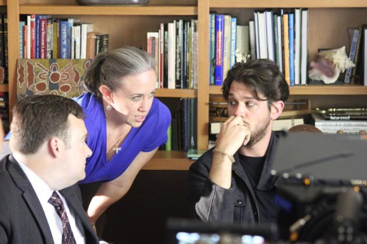 two men and woman in a conversation
