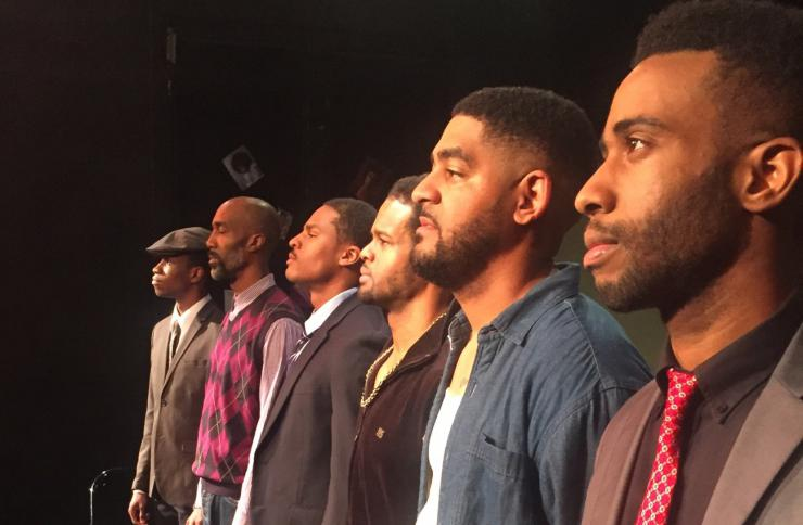 six Black actors stand in a line