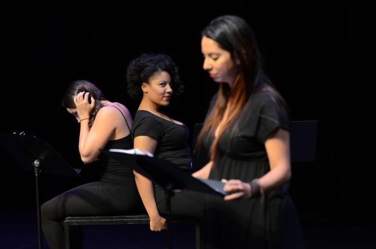 three women at a staged reading