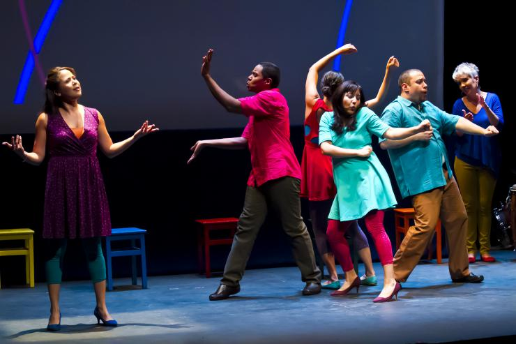 a group of people dancing on stage