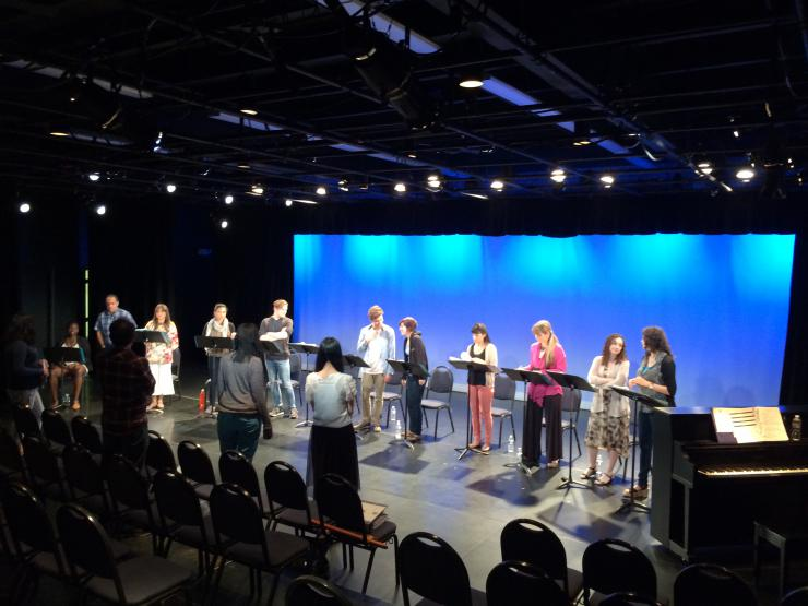 Actors in a line doing a staged reading