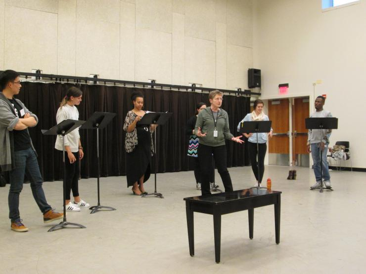 group of actors in rehearsal