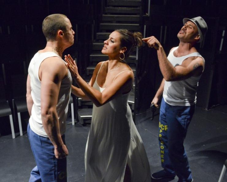 two actors and an actress in a fight scene on stage