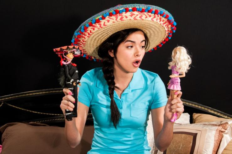 an actress in a sombrero playing with dolls