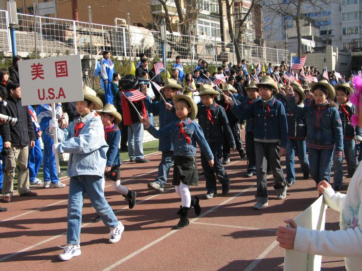 children marching with flags