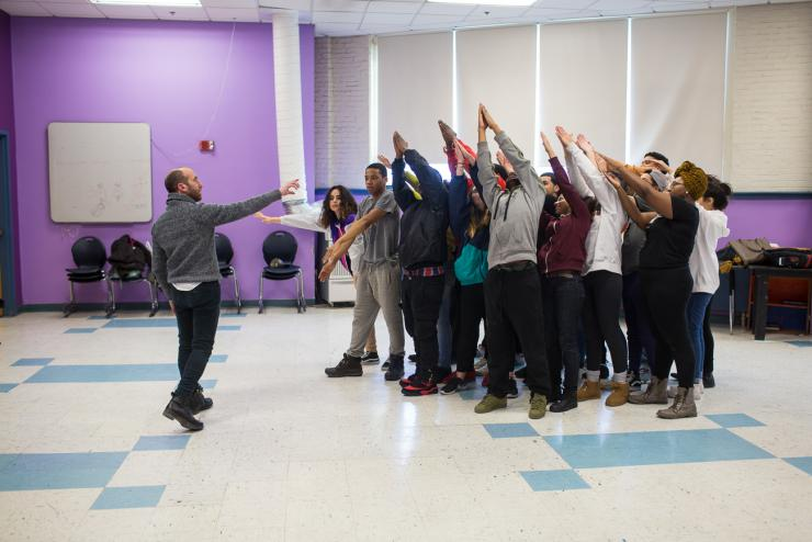 Yo-El Cassell guides students in a movement exercise