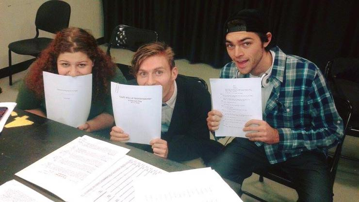 three writers posing with scripts
