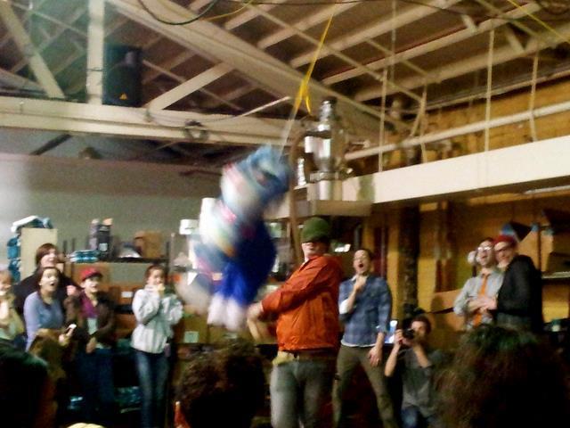 a man hitting a piñata