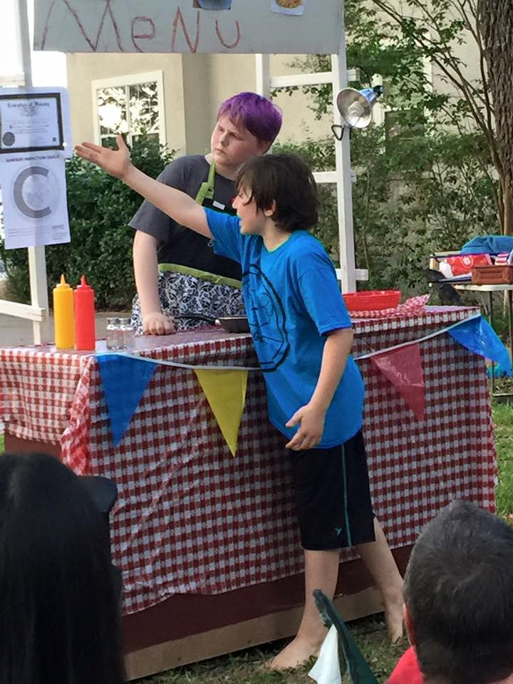 two children performing outdoors