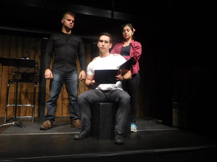 three actors in rehearsal