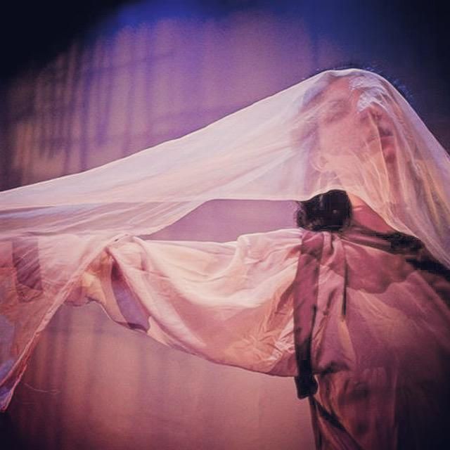 an actress acting under a sheet