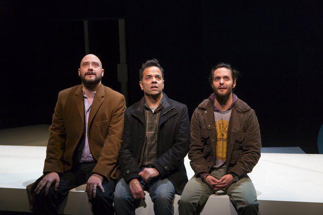 three men on stage