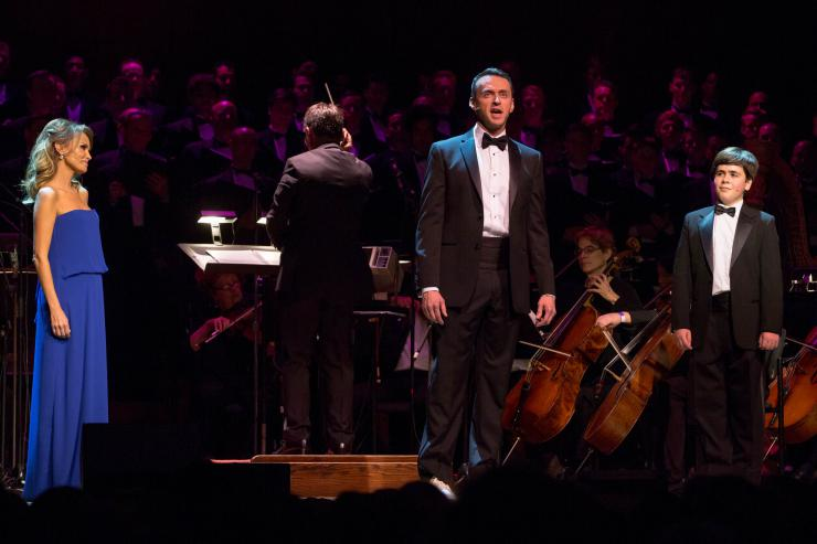 actors singing with an orchestra