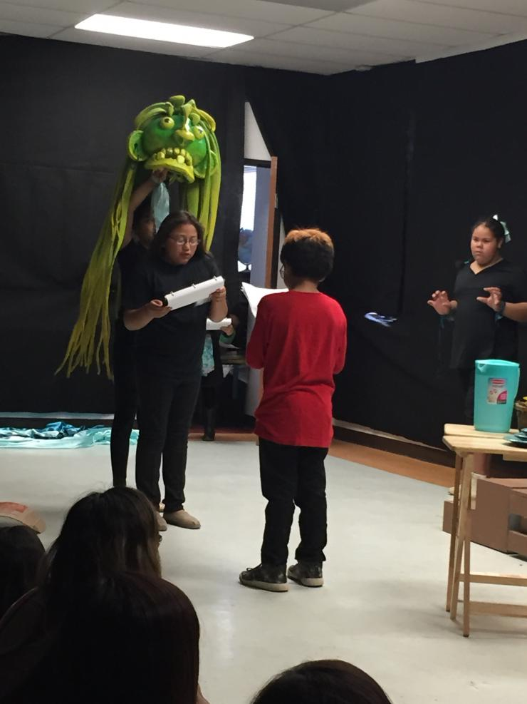 students working with a puppet