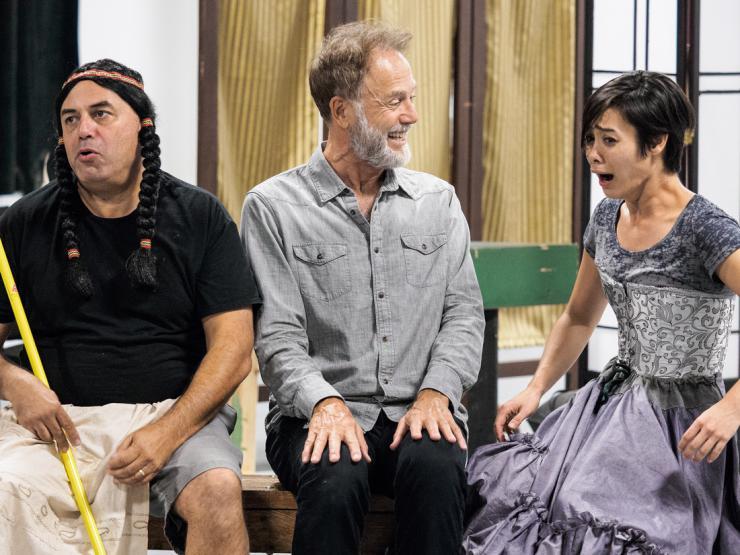 three actors in rehearsal