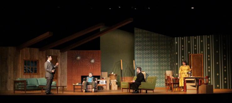 a group of actors in a living room on stage