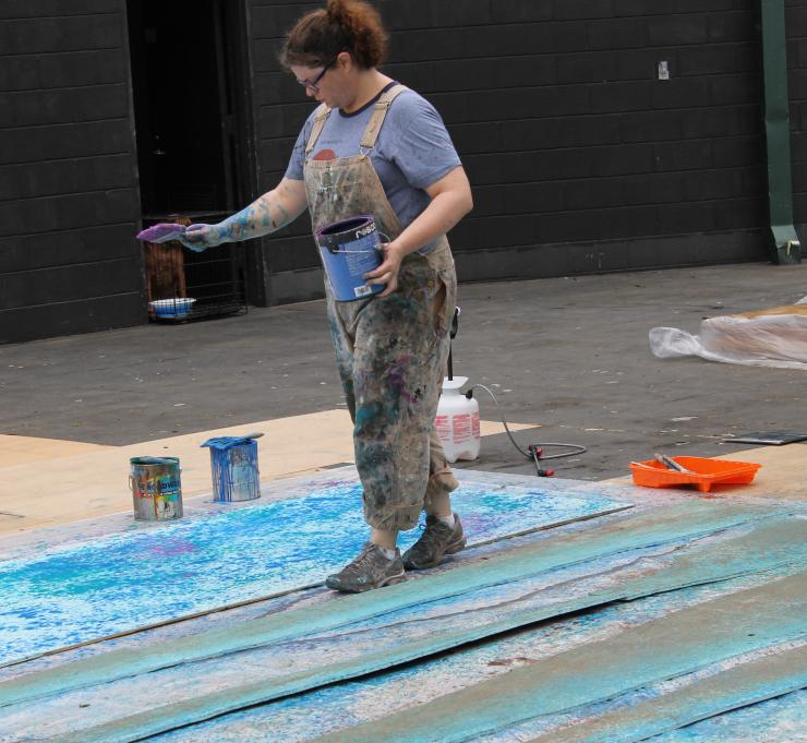 a woman painting a set