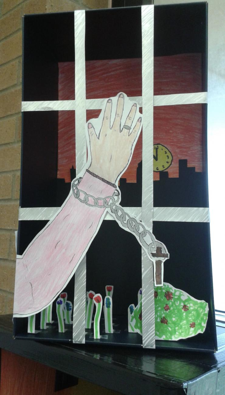 drawing of a chained hand over bars