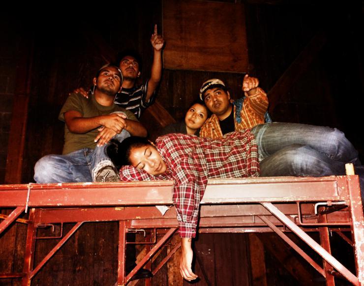Five actors on scaffolding