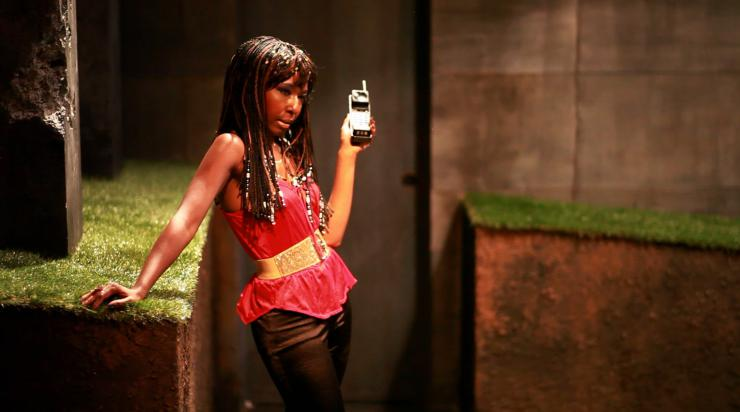 a woman on stage holding a phone