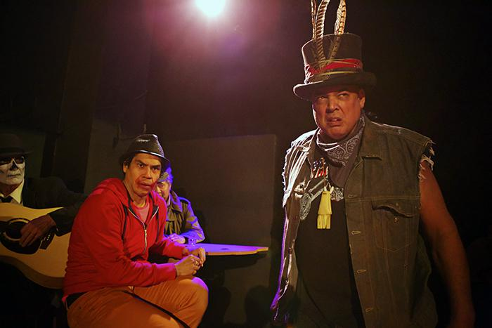 two actors on stage in costume