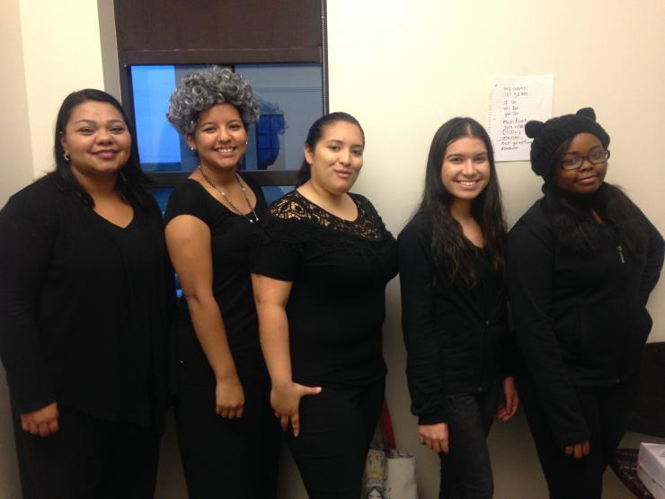 five women of color posing for a photo