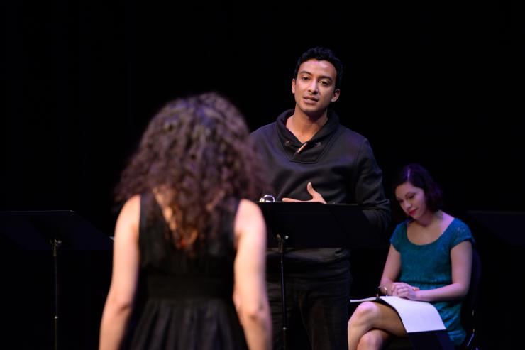 two actors in a staged reading